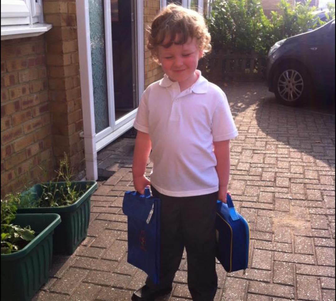 Summer born child on the first day of school