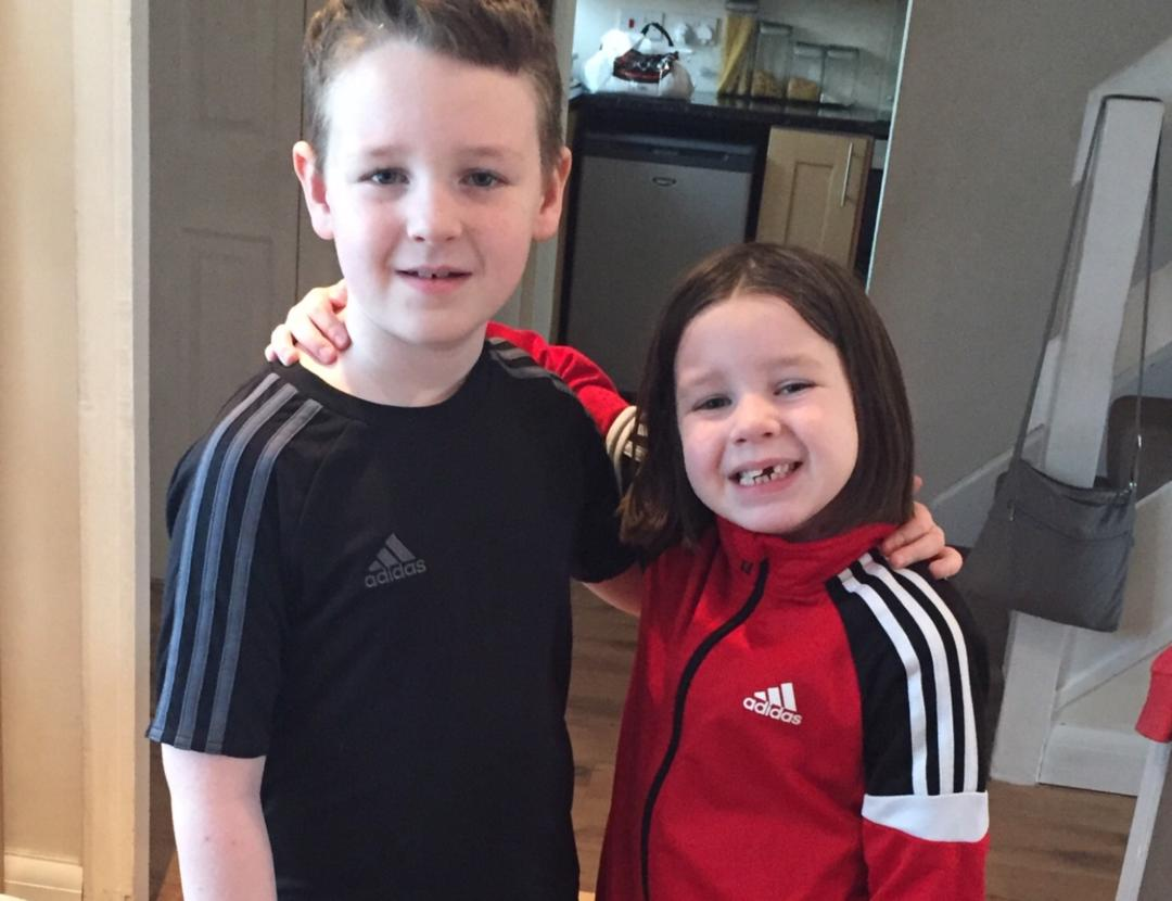 Boy and a girl in football kit