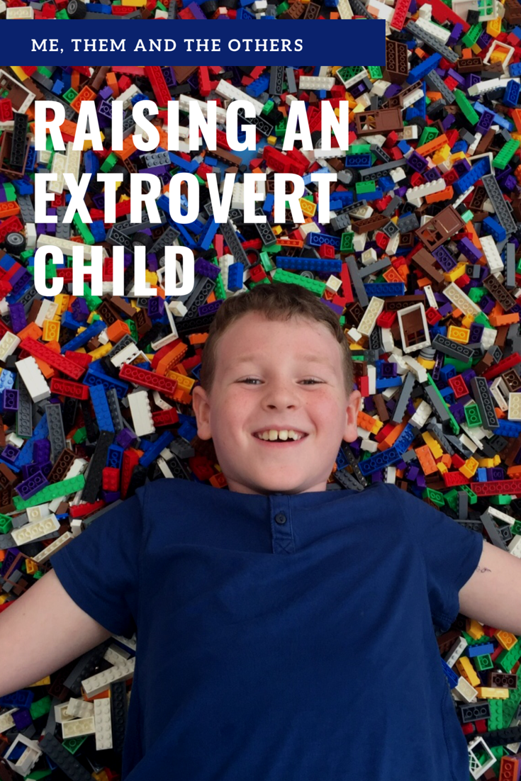 Raising an introvert Child - boy laying in Lego
