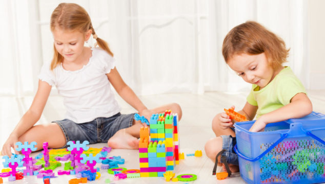 Older children playing with toys