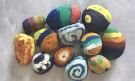 Rocks decorated with melted crayon