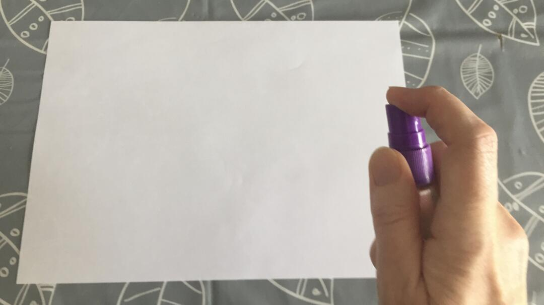Spraying the paper to make it wet