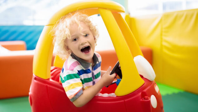 Toddler in a ride on toy