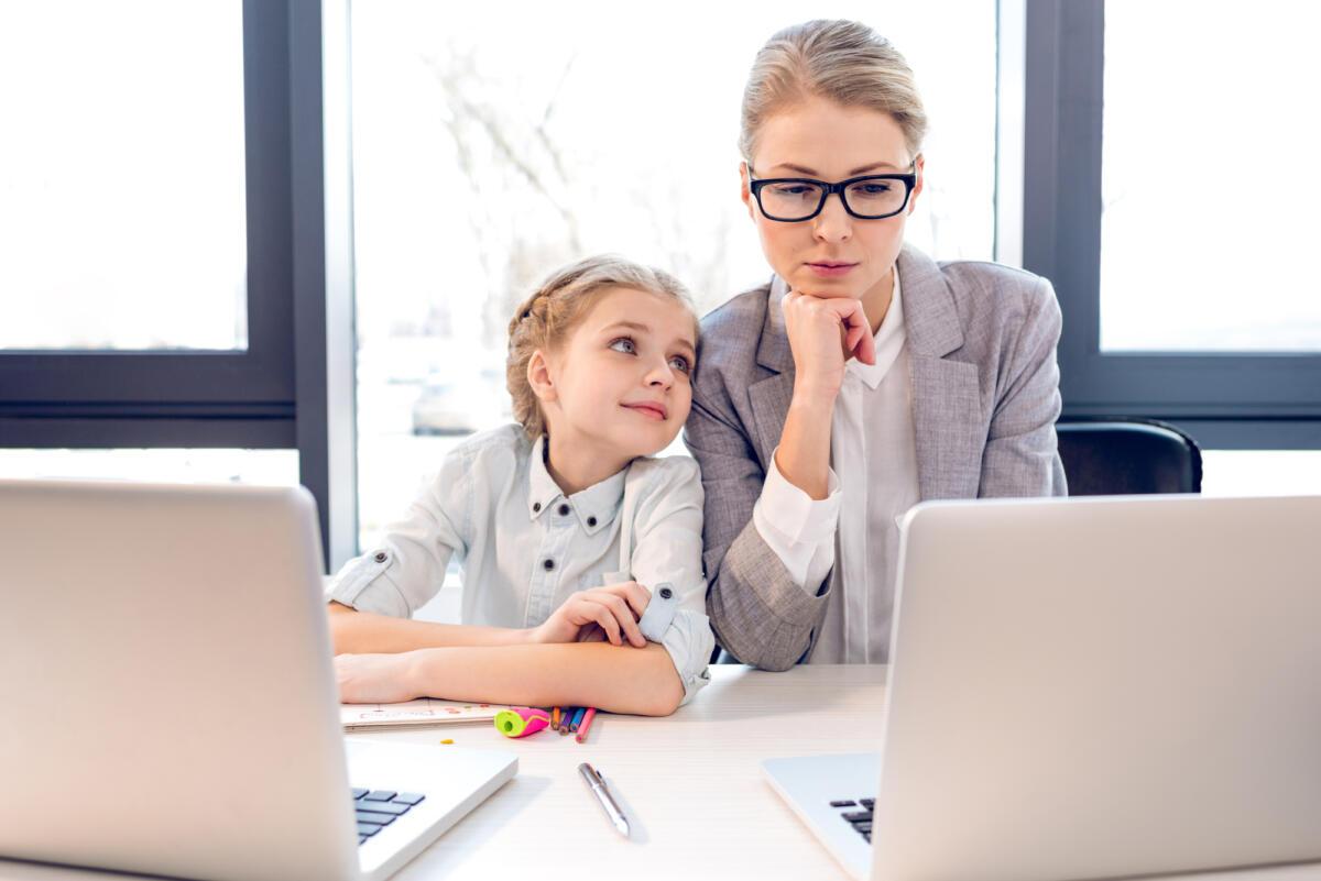 Work at home mum writing with child