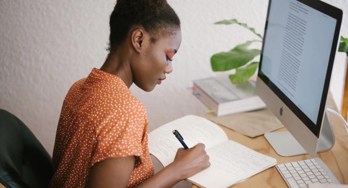 Woman writing at home