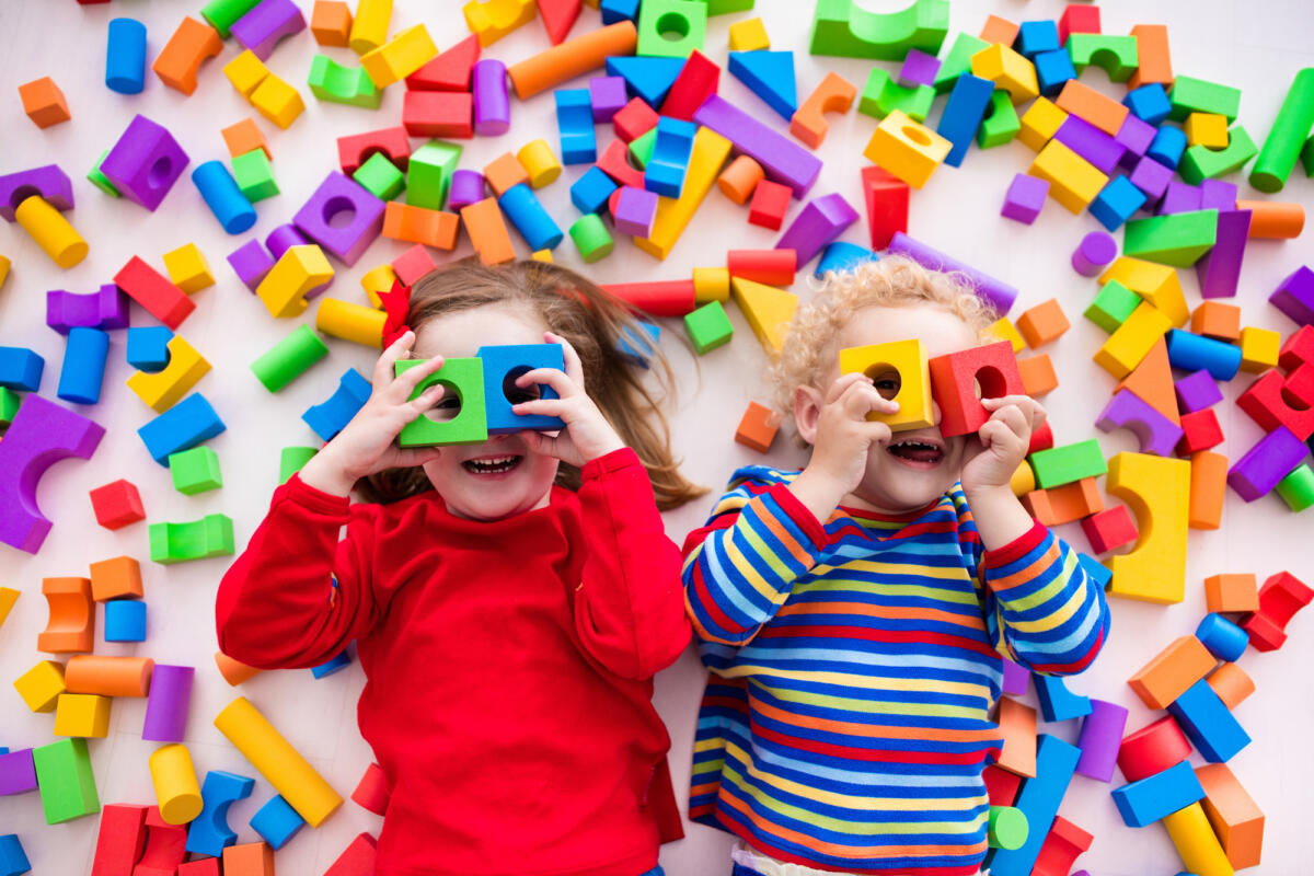 Toddlers playing with construction building blocks