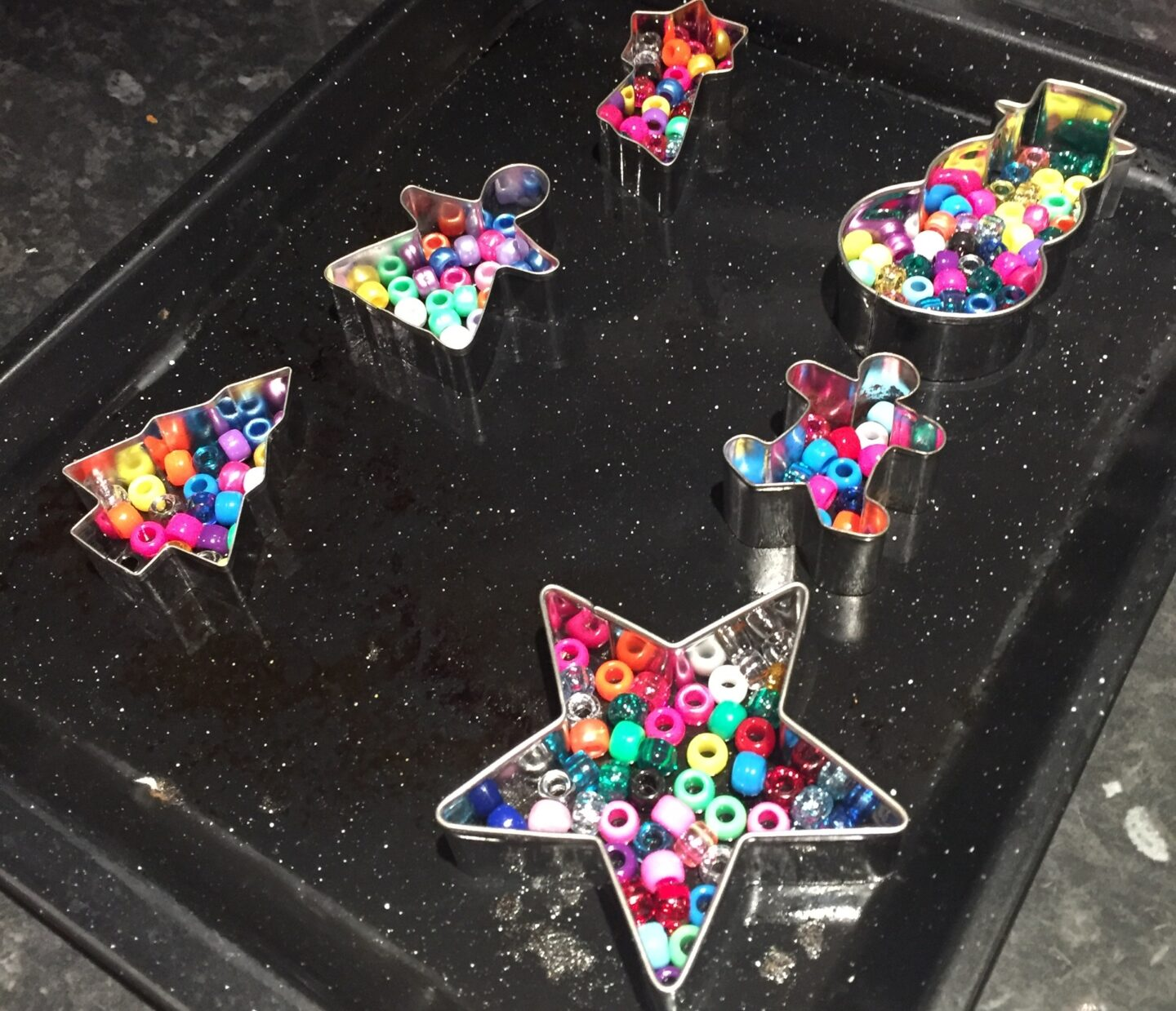 Melted bead ornaments ready to go in the oven