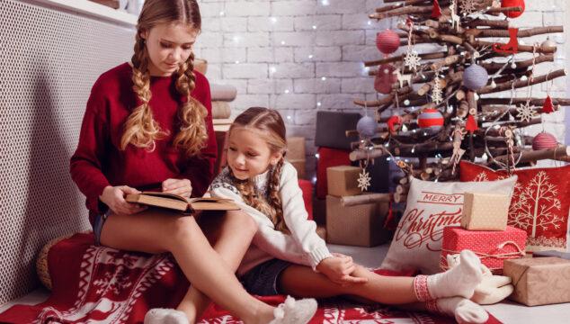 Older children Reading Christmas chapter books