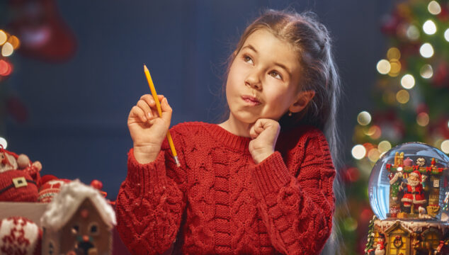 Child Writing at Christmas
