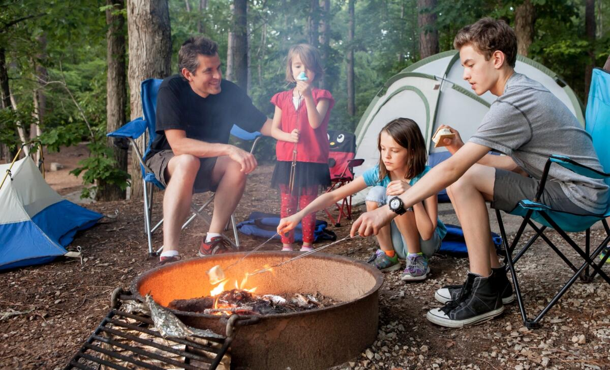 Dad and children camping