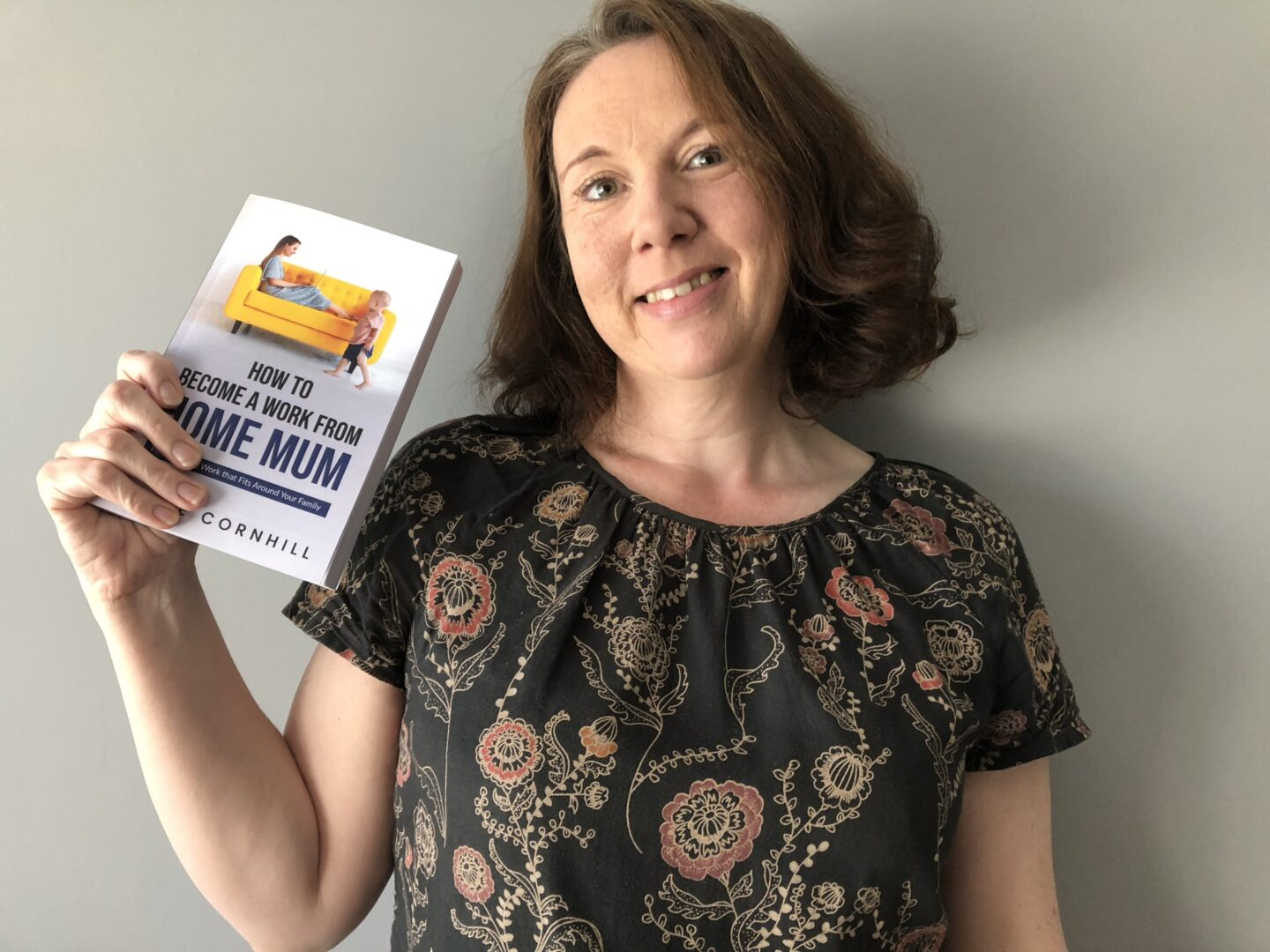 Author holding work from home mum book