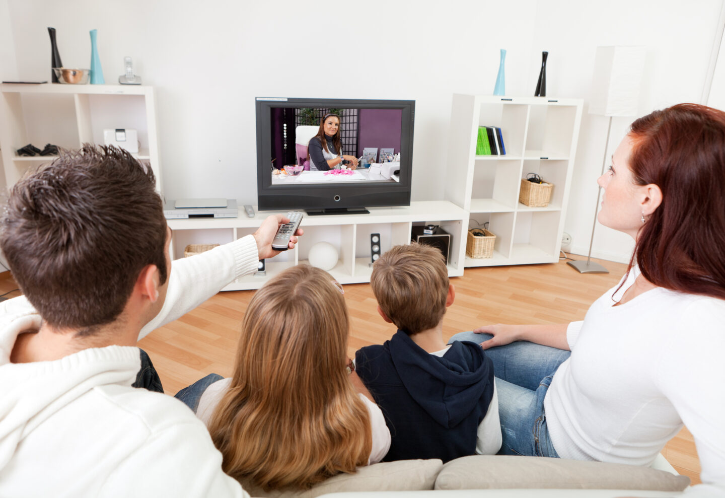 Family watching Netflix TV together on the sofa
