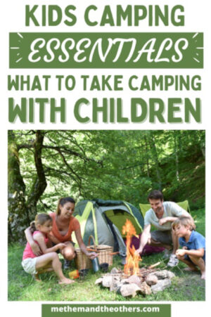 Two adults and two children around a camp fire, tent in the background, text reads: Kids camping essentials, what to take camping with children