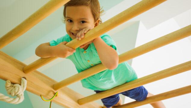 Toddler on an indoor climbing frame